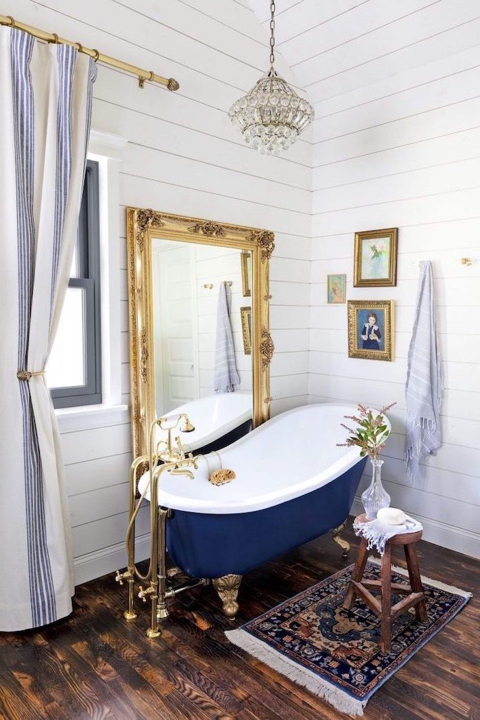 blue and white vintage bathtub vintage mirror next to it bathroom decorating ideas pictures wooden floor and walls
