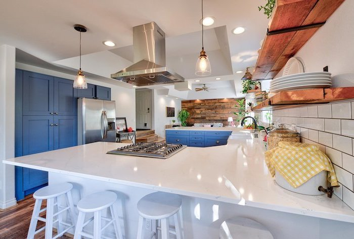 blue cabinets white countertops modern farmhouse kitchen open shelving wooden backsplash white tiles on the other wall