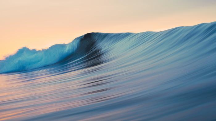 blue ocean wave close up photograph cute computer backgrounds orange sky at sunset
