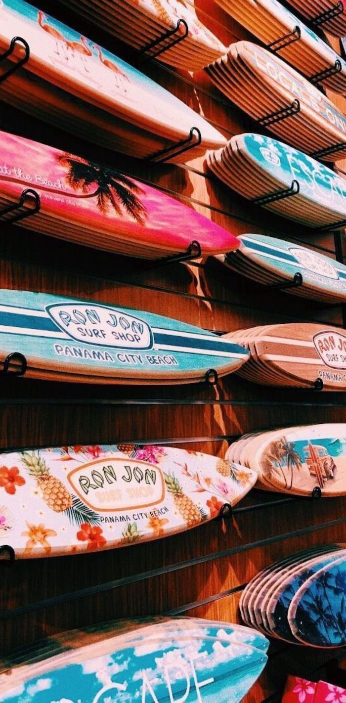 blue pink purple orange white surfboards arranged on wooden wall with different summer themed prints on them vsco wallpaper