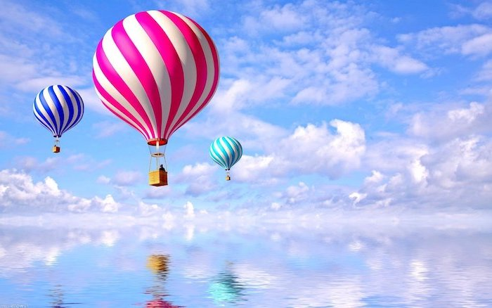 blue sky with lots of white clouds free wallpaper for computer colorful hot air balloons in the sky above blue water
