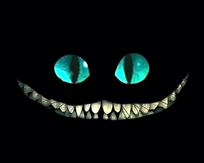 cheshire cat smiling high resolution desktop wallpaper turquoise eyes large smile with teeth on black background