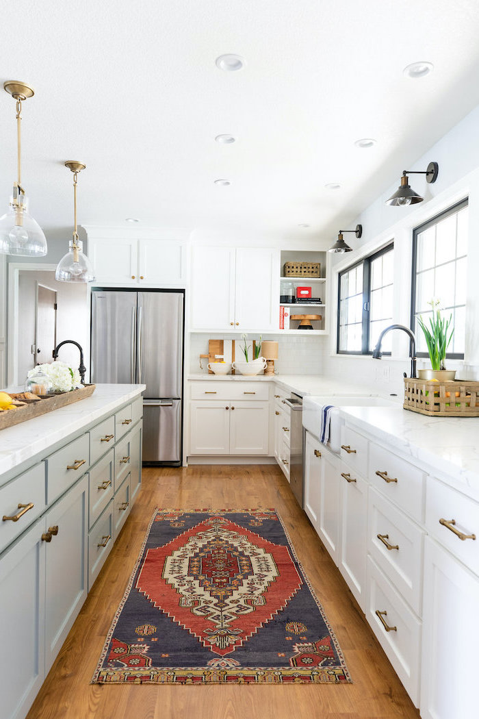 colorful carpet on wooden floor white cabinets with marble countertop white farmhouse kitchen