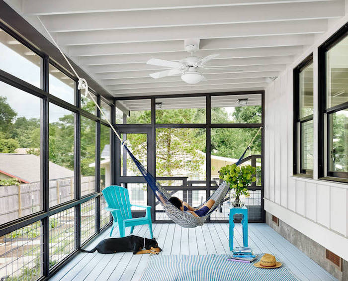 covered porch ideas white wooden ceiling wall hammock hanging from the ceiling turquoise armchair