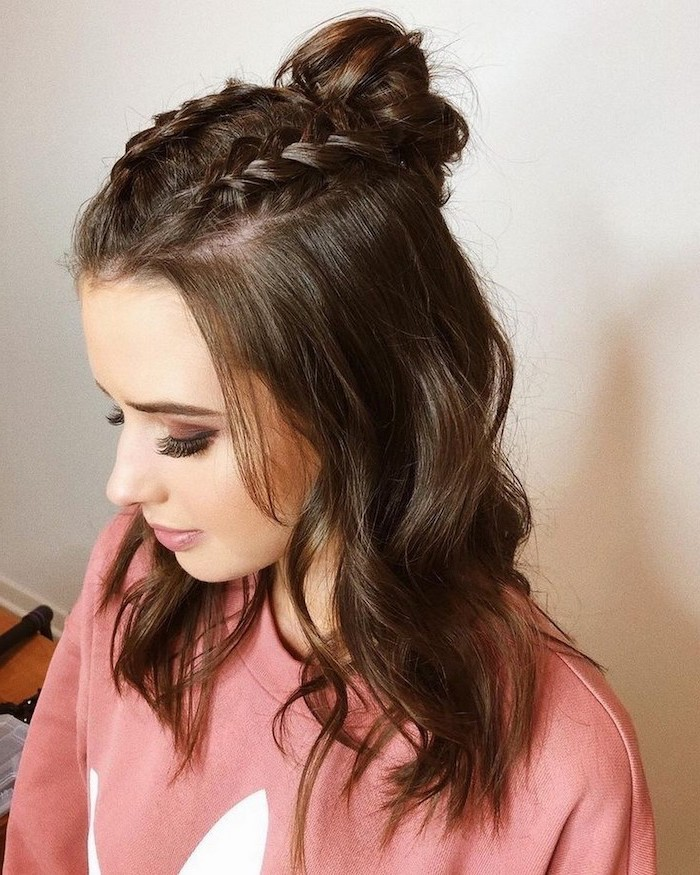 cute easy hairstyles for school woman with brown shoulder length wavy hair two braids on top ending with a bun