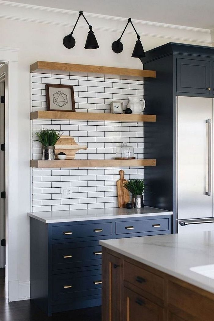 dark blue cabinets with white countertops farmhouse kitchen cabinets white subway tiles backsplash wooden shelves wooden kitchen island