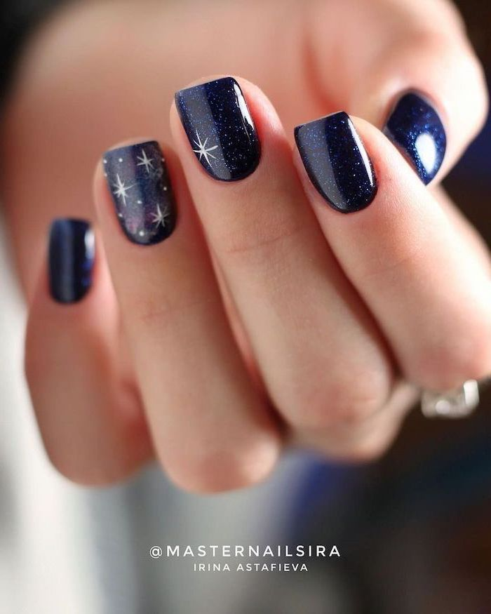 dark blue glitter nail polish on medium length square nails decorations with white stars fall nail designs