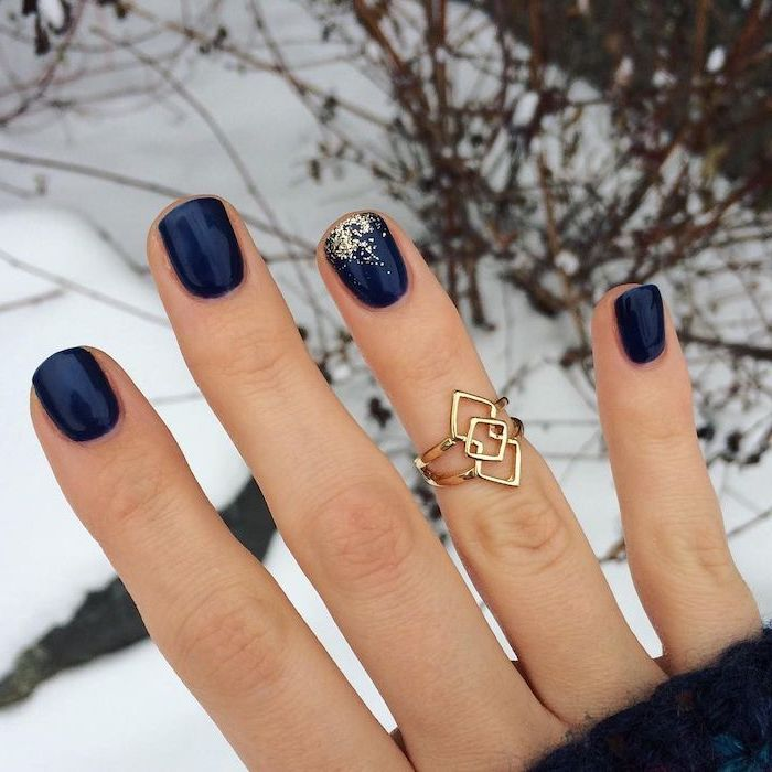 dark blue nail polish on short squoval nails short nail designs gold glitter on the ring finger and golden ring