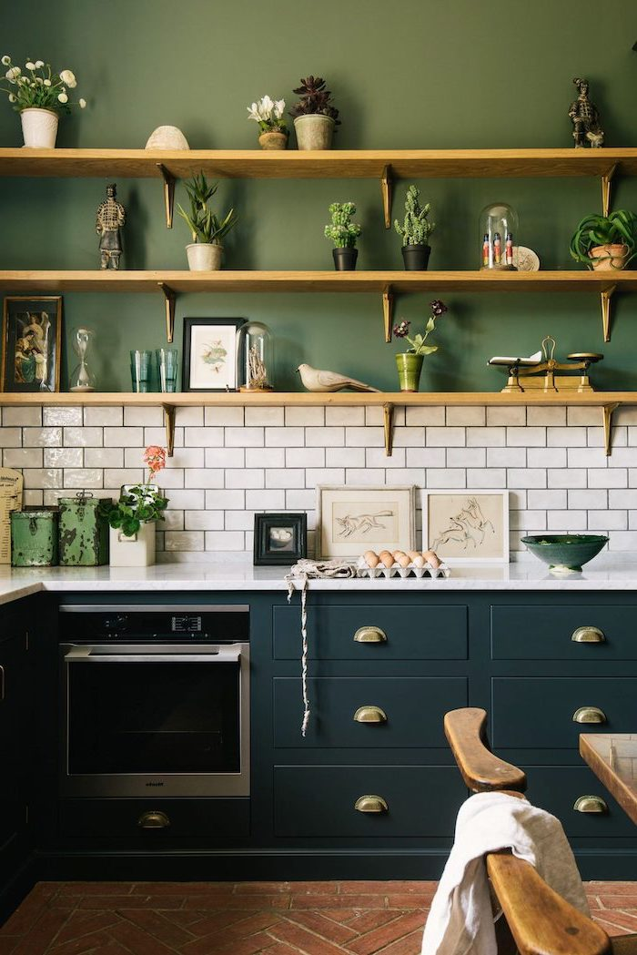 dark green cabinets with white countertop green wall with wooden shelves kitchen backsplash pictures white subway tiles