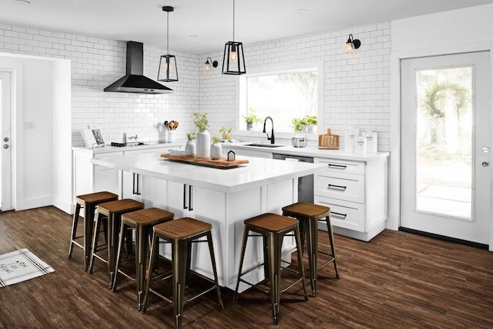 dark wooden floor white subway tiles bar stools around white kitchen island modern farmhouse decor ideas