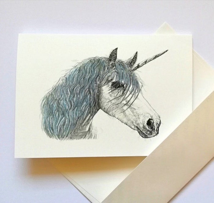 drawing of a unicorn with black and blue pencil on white background how to draw animals step by step