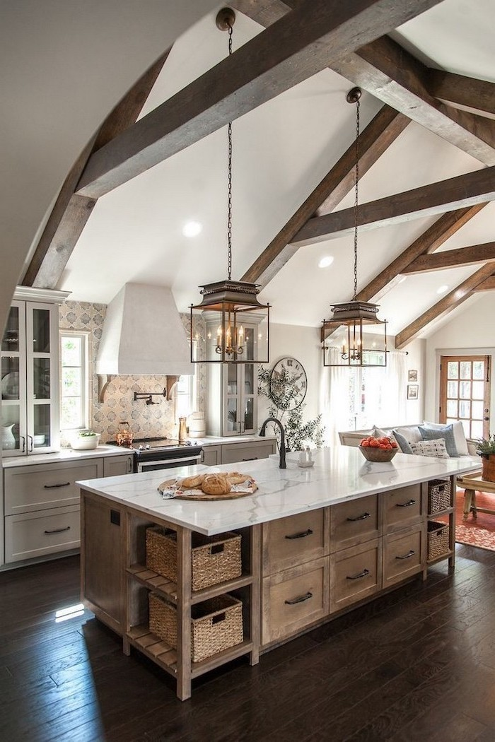 exposed wood beams on cathedral ceiling farmhouse kitchen decor wooden kitchen island with marble countertop vintage patterned tiles backsplash