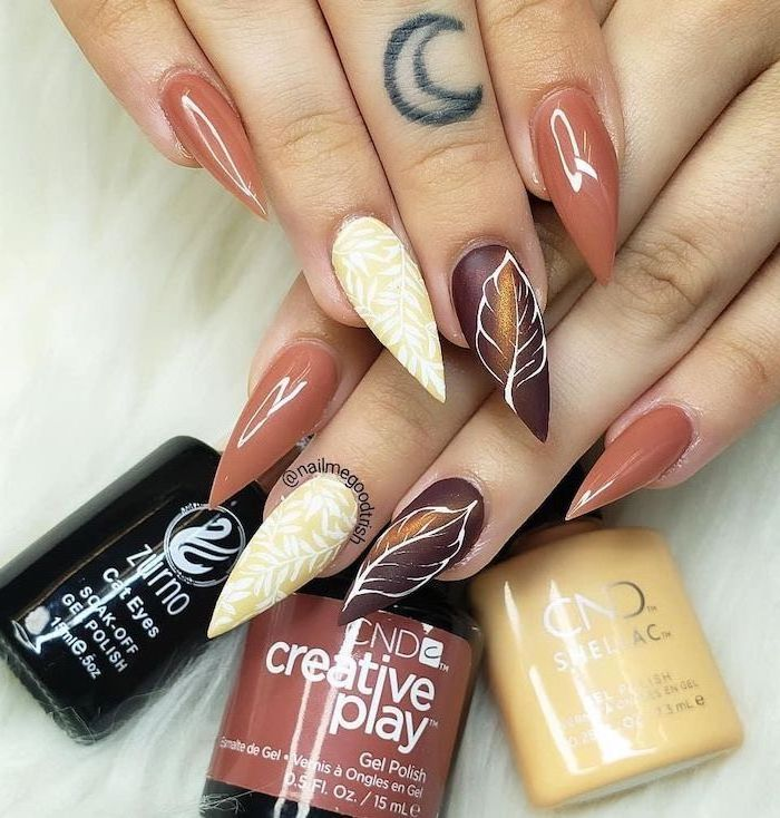 fall nail designs orange brown and yellow nail polish decorations of fall leaves on the ring and middle fingers long stiletto nails