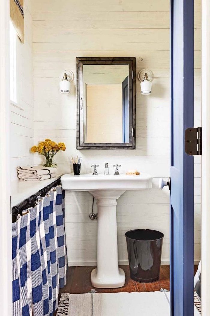 farmhouse bathroom blue dorr blue and white curtain small bathroom remodel vintage sink with mirror above it wooden floor