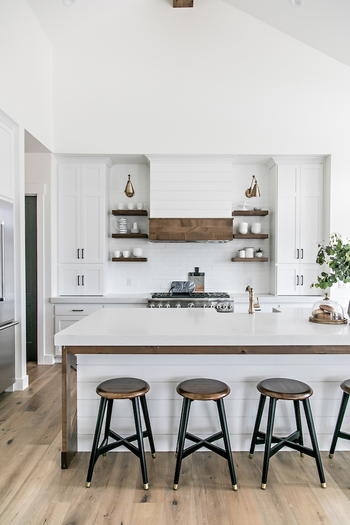 farmhouse kitchen backsplash in white black metal bar stools next to kitchen island with white countertop open shelving