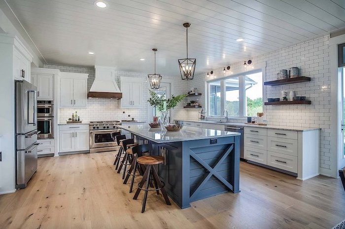 farmhouse kitchen decor dark gray wooden kitchen island with granite countertop wooden floor white backsplash subway tiles