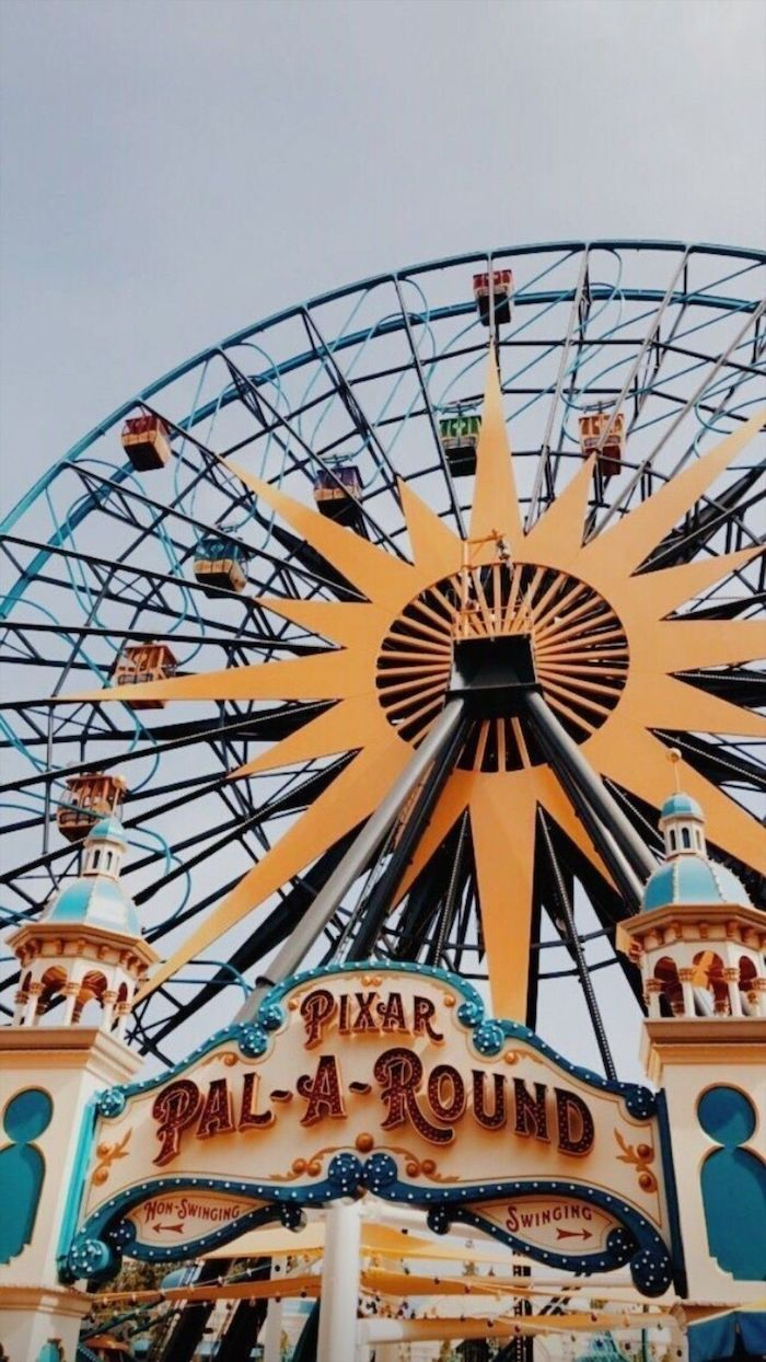 ferris wheel pixar pal a round photographed from below iphone cute backgrounds clody sky in the background