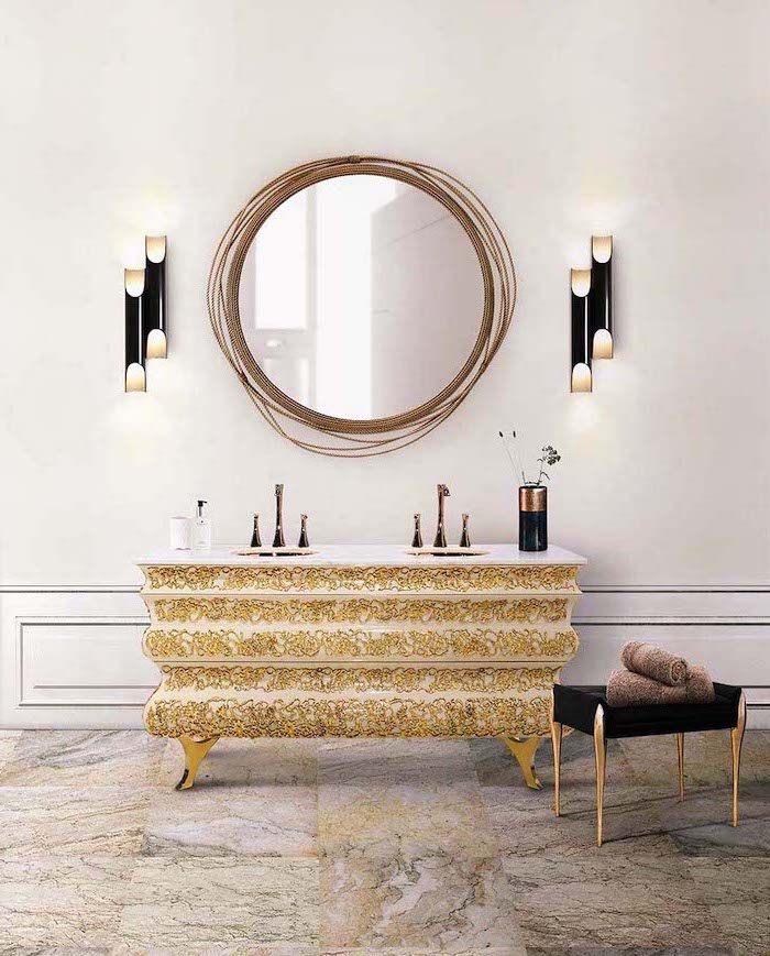 golden accents on vintage cabinet with two sinks round mirror above it bathroom picture ideas vintage ottoman on the side