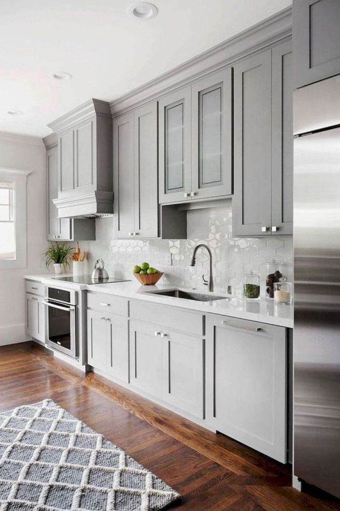 gray cabinets dark wooden floor white tiles backsplash farmhouse kitchen cabinets gray and white carpet
