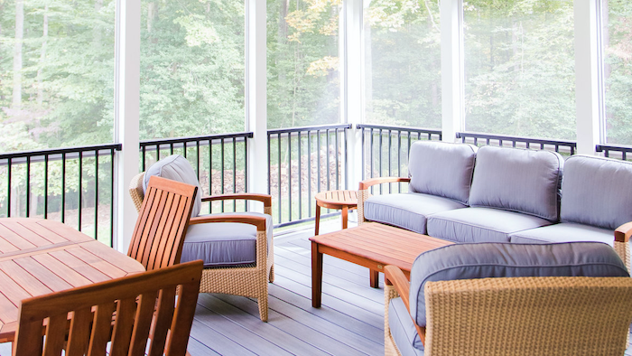 gray cushions on wooden garden furniture set screened in back porch wooden coffee table placed on wooden floor