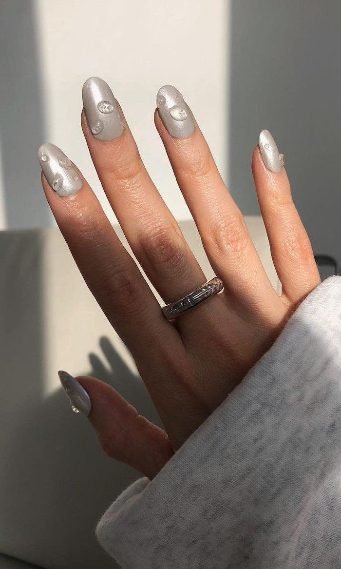 gray metallic nail polish with raindrop decorations on each finger summer nail designs medium length almond nails