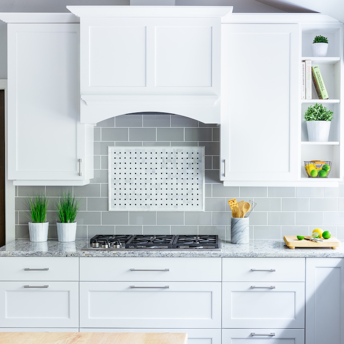 gray tiles above the stove backsplash for white cabinets white cabinets with granite countertop