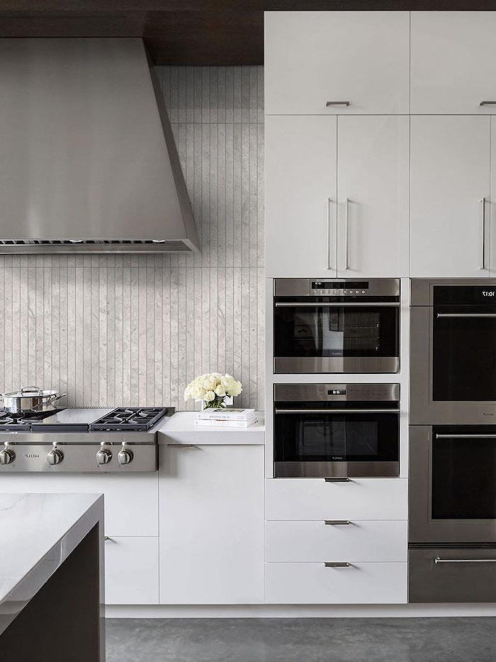 gray tiles backsplash modern kitchen backsplash white cabinets granite floor stainless steel appliances