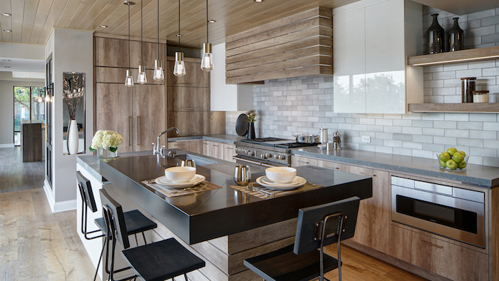 gray tiles backsplash wooden kitchen island with black countertop black bar stools farmhouse kitchen cabinets wooden cabinets