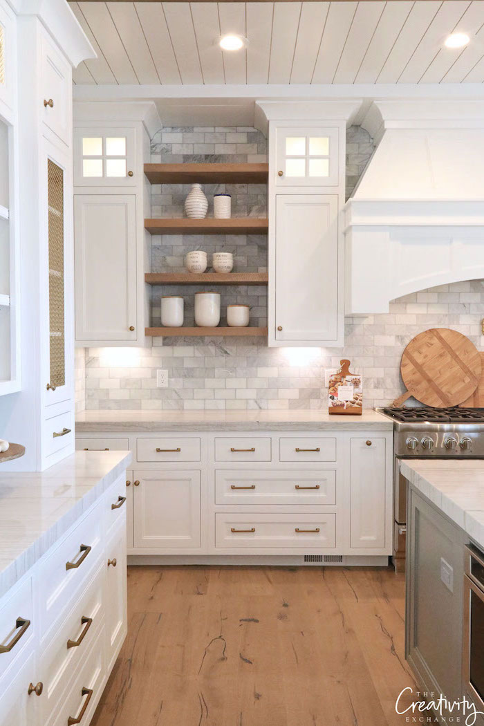 gray tiles in different shades backsplash open shelving modern farmhouse kitchen white cabinets white countertop wooden floor