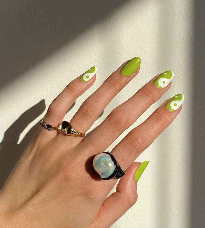 green and white nail polish nail designs for short nails almond nails with yin yang decorations