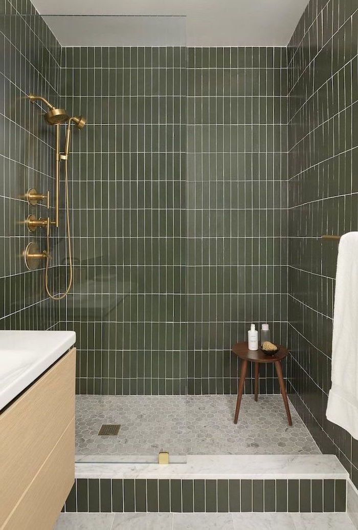 green tiles on the walls small bathroom remodel ideas honeycomb tiles on the floor in shower cabin with brass shower head