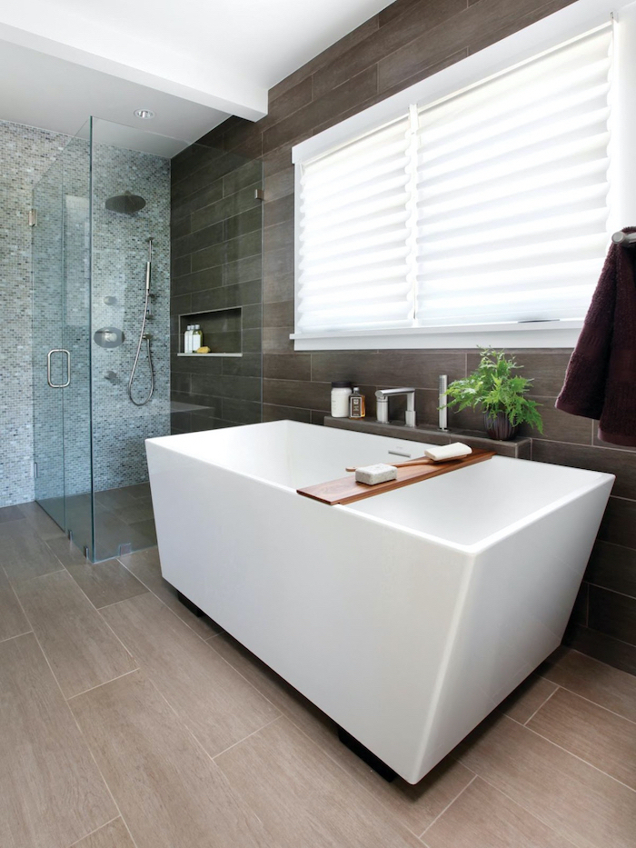 grey mosaic tiles on one wall wooden accent wall floor small bathroom remodel glass shower cabin white bathtub