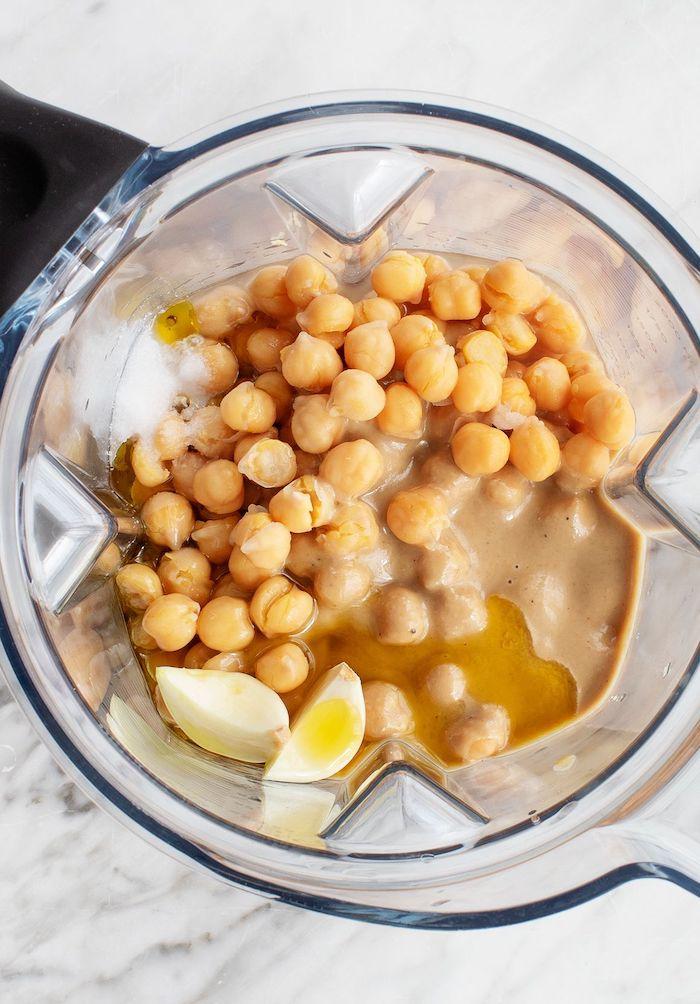 how to make chickpea hummus roasted chickpeas snack ingredients inside blender chickpeas garlic olive oil salt