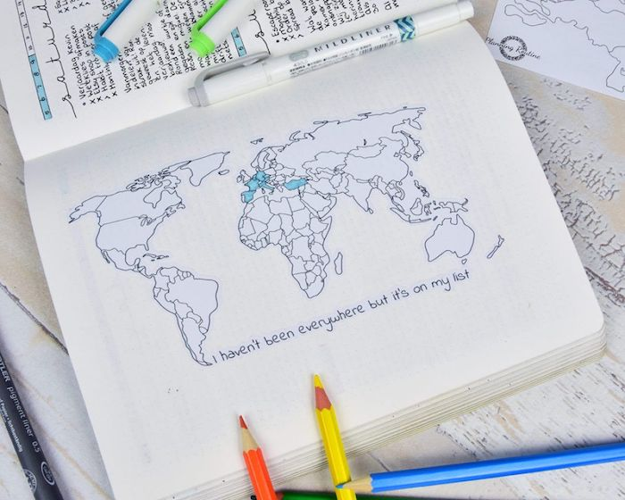 i haven't been everywhere but its on my list written underneath map of the world bullet journal ideas lots of pencils around it