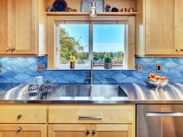 kitchen backsplash ideas tiles in two different shades of blue wooden cabinets with stainless steel countertop small window