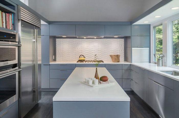 light blue cabinets and kitchen island with white countertops subway tile backsplash white backsplash