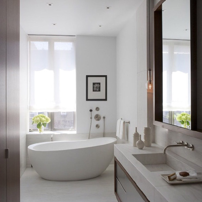 marble countertop on wooden floating shelf large mirror above it how to decorate a bathroom white walls floor bathtub