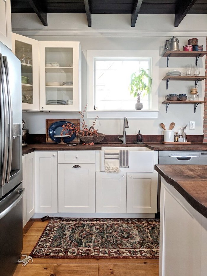 modern farmhouse kitchen decor white cabinets dark wooden countertops open shelving colorful carpet on wooden floor