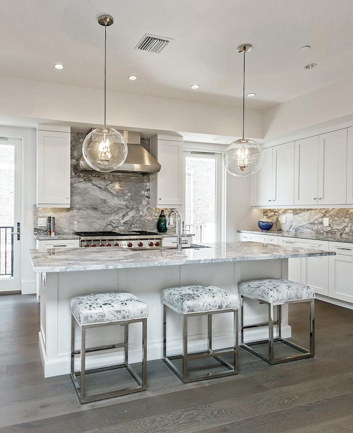 modern kitchen backsplash wooden floor white cabinets and kitchen island marble backsplash and countertops