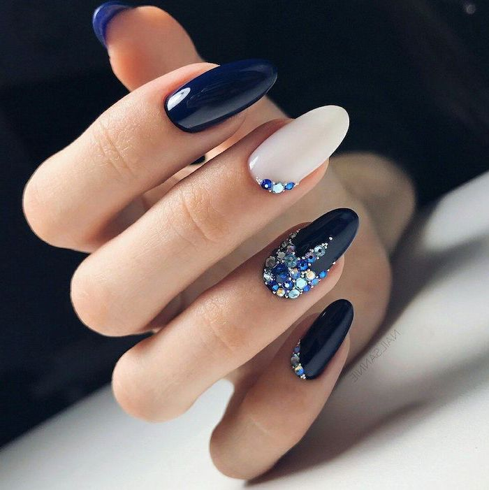 nail ideas 2020 dark blue and white nail polish decorations with blue and white rhinestones on pinky ring and middle fingers