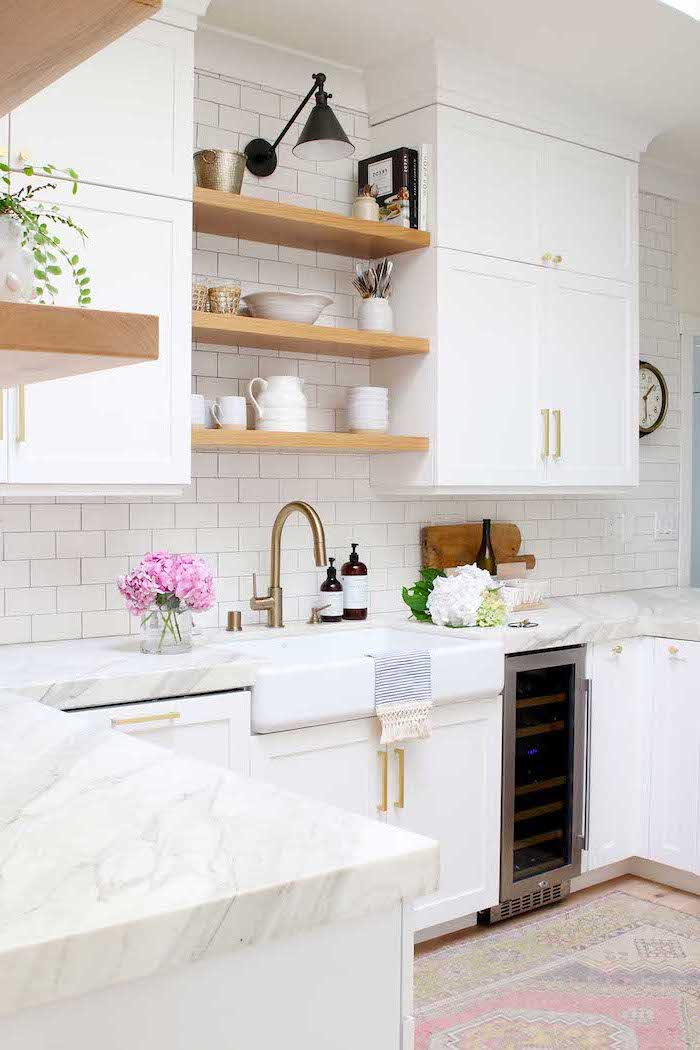 open shelving on white subway tiles white cabinets with marble countertop farmhouse kitchen backsplash colorful carpet