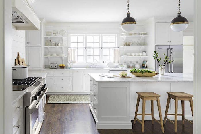 open shelving white kitchen island and cabinets with marble countertops rustic farmhouse kitchen white wooden walls