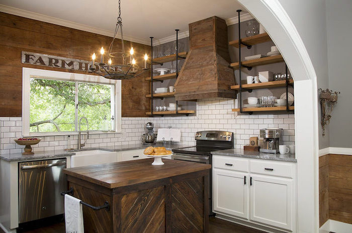 open shelving wooden kitchen island vintage chandelier white cabinets modern farmhouse kitchen white tiles backsplash