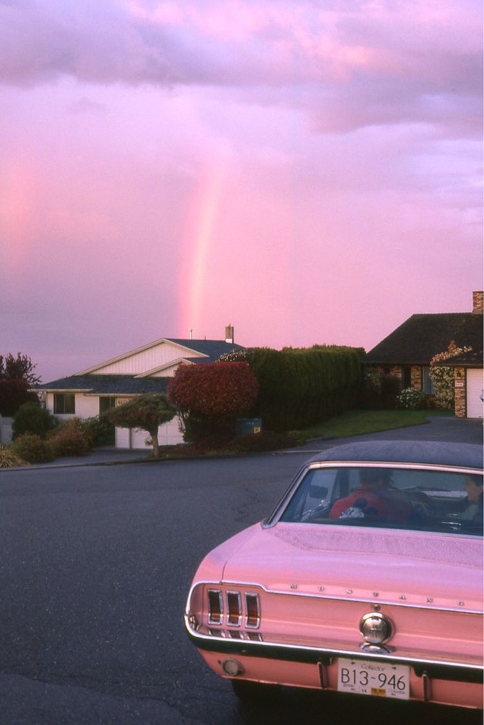 pink car at the forefront cute aesthetic wallpapers houses in the background purple pink sky above them