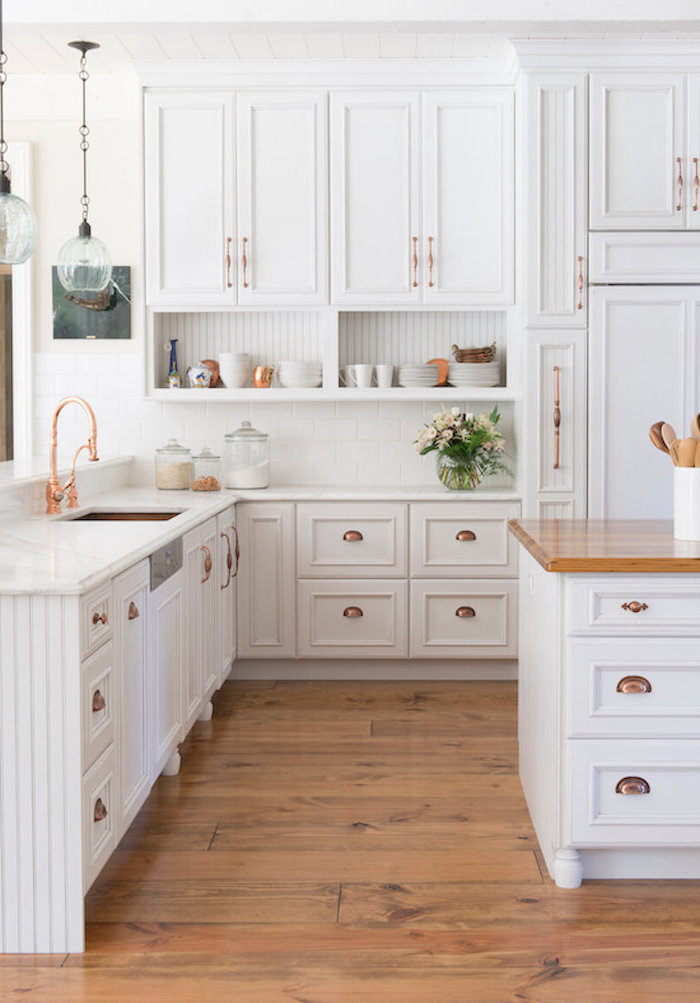 rose gold fixtures white cabinets white marble countertops farmhouse kitchen decor wooden floor white kitchen island with wooden countertop