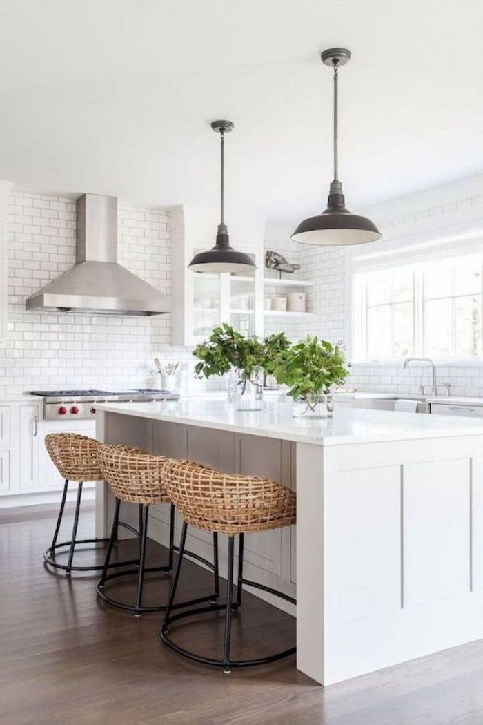 rustic farmhouse kitchen white kitchen island black bar stools on wooden floor white subway tiles backsplash