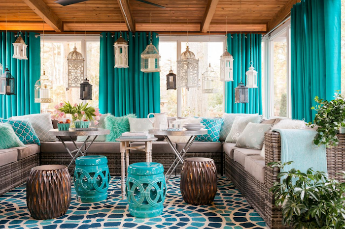 screened in porch ideas turquoise curtains wooden floor large sofa with white cushions turquoise throw pillows coffee tables ottomans