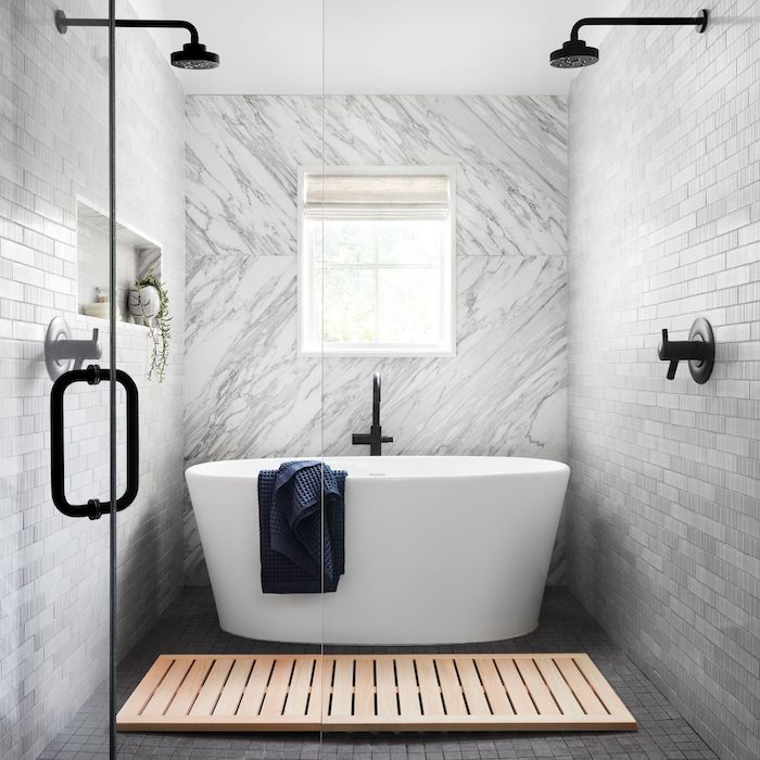 small bathroom remodel ideas marble tiles accent wall black shower heads grey subway tiles white bathtub