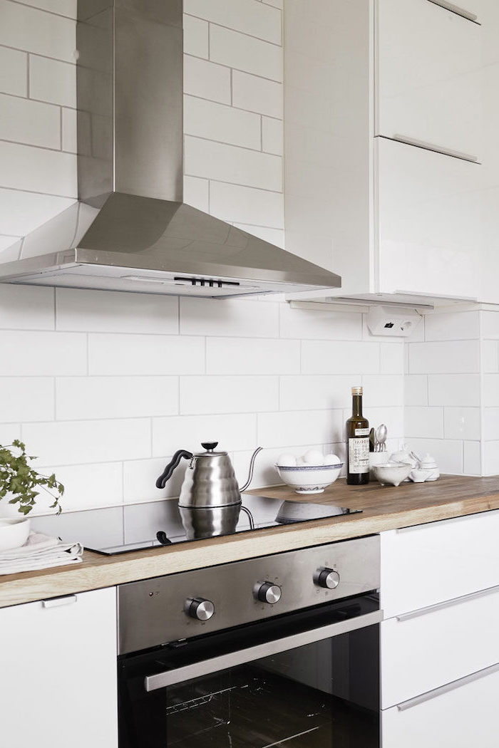 stainless steel appliances white cabinets with wooden countertop kitchen backsplash ideas with white cabinets white subway tiles for backsplash