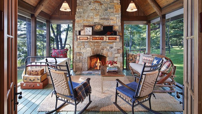 stone fireplace under cathedral ceiling screened in porch ideas bed sofa rocking chairs coffee table arranged in front of fireplace